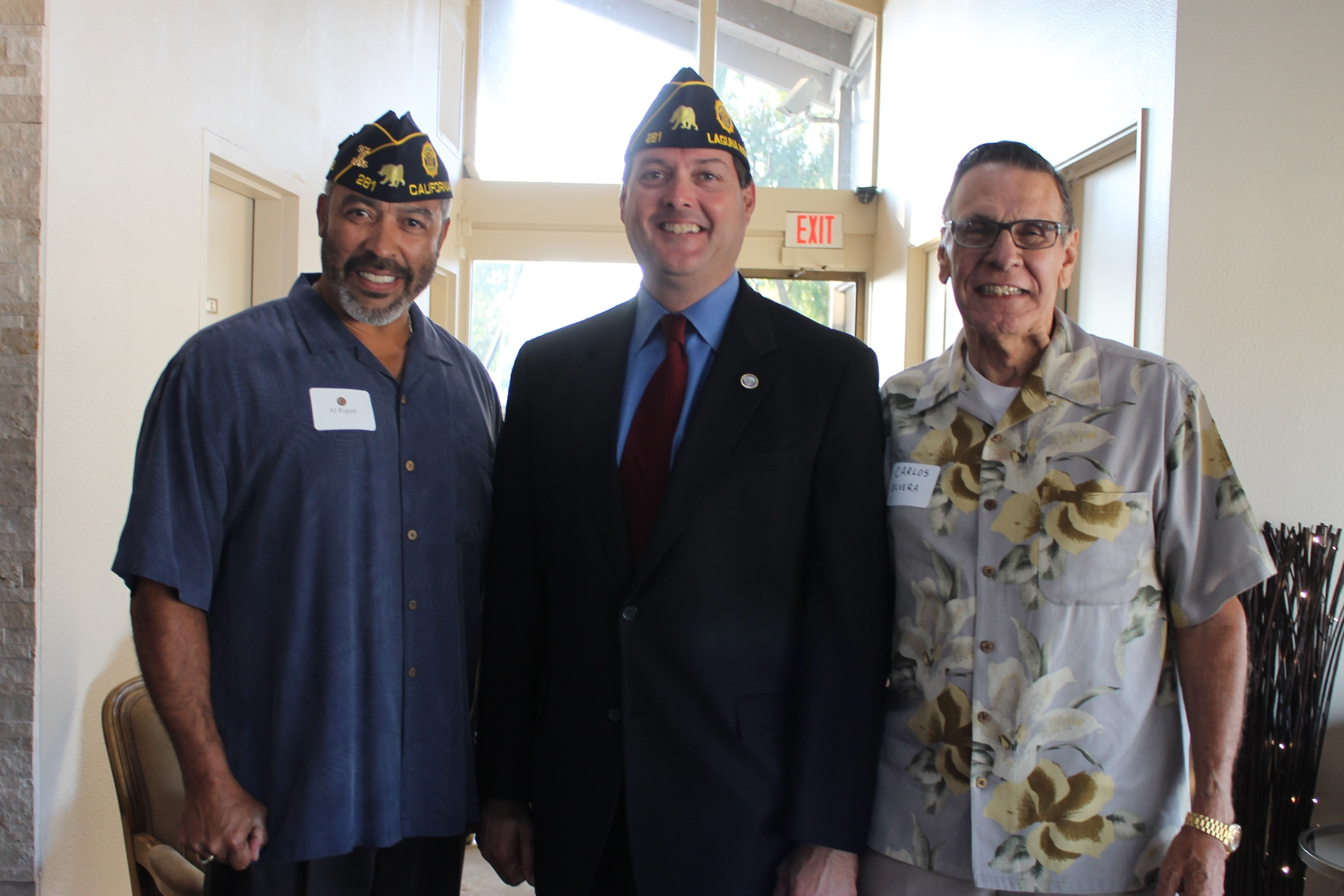 (L to R) Al Rigual, of Laguna Niguel, is joined by Dana Point Councilmen Bill Brough and Carlos Olvera at a welcoming party for American Legion Post 281 on Monday. Photo by Andrea Papagianis