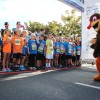 Drumstick the Turkey Trot mascot gets young competitors pumped up before the Gobble Wobble Thursday. Photo by Andrea Papagianis