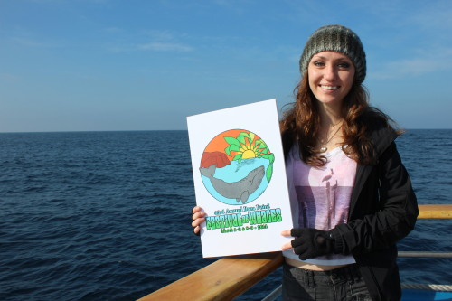 Dana Hills High School graduate Sarah Holen's logo design was chosen by Dana Point Festival of Whales organizers as the face of the 43rd annual event. Here, Holen displays her design on a whale watching trip aimed to inspire students for next year's logo contest. Photo by Andrea Papagianis