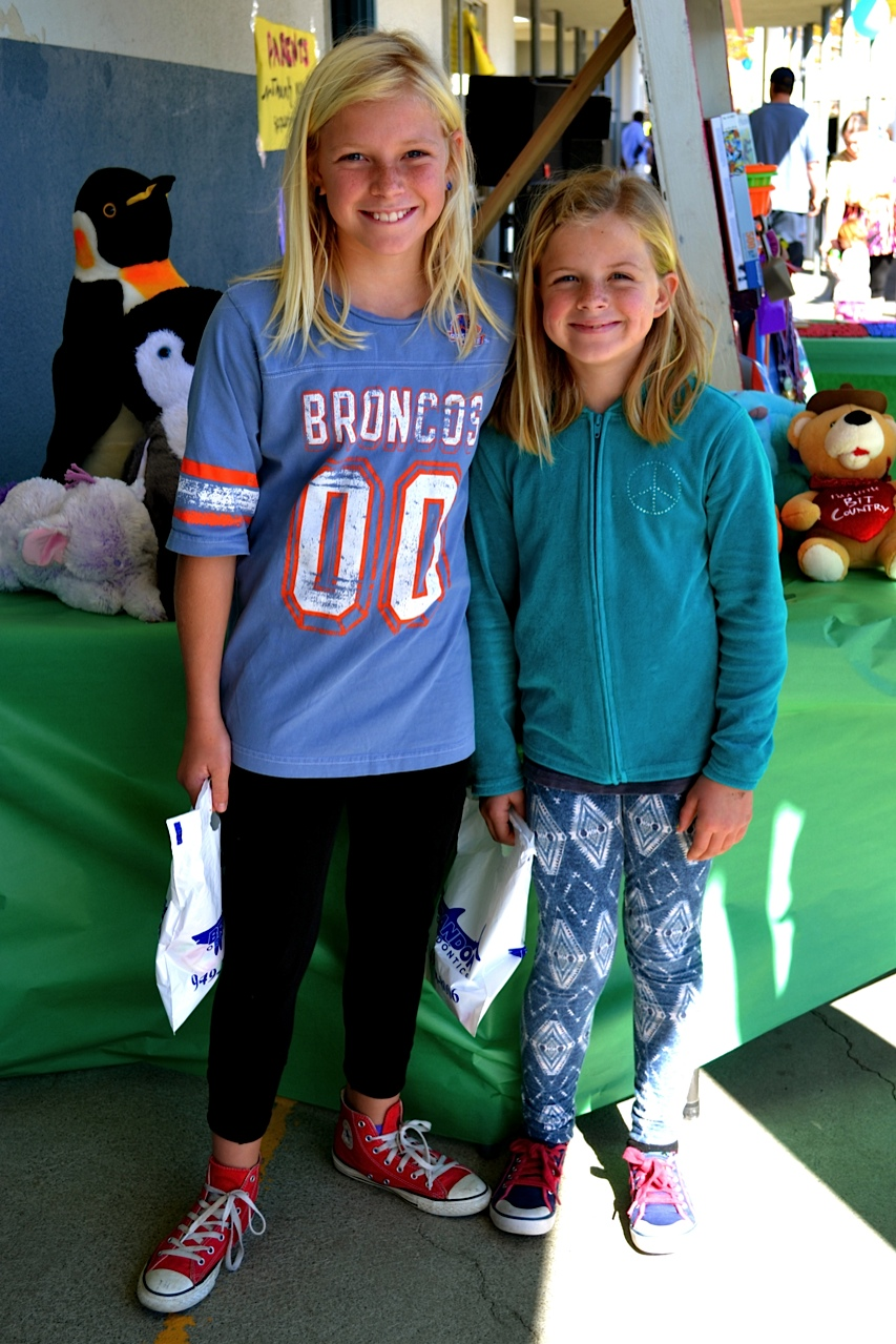 Lilah and Daisy Kopenhefer enjoy the festivities Saturday at Palisades Elementary School. Photo by Madison May