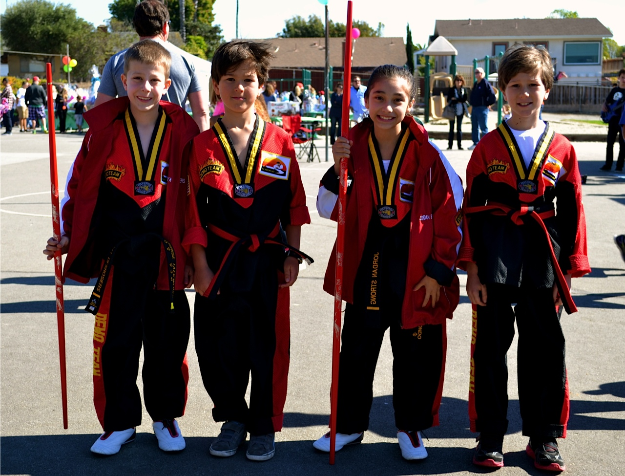 Kyle, Max, Jordan and Spencer from Sunrise Tai Kwon Do stop for a photo after their martial arts demonstrations. Photo by Madison May