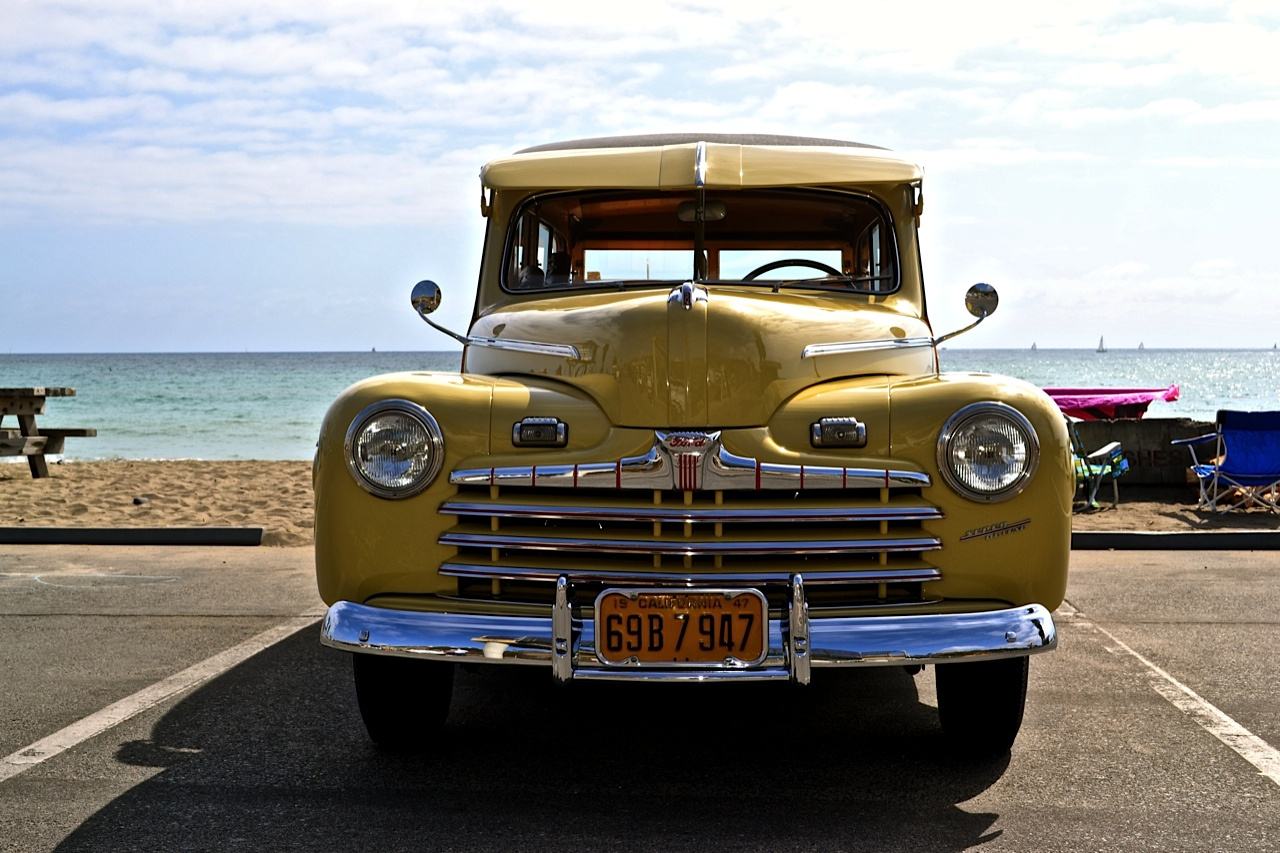 Dozens of wood-paneled, classic cars line Doheny State Beach Saturday at the annual Doheny Wood car show. Photo by Madison May