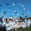 Celebrating the culmination of their elementary, junior high and high school academic years, the 655 graduates of Dana Hills High School's class of 2014 toss their caps into their air Tuesday, June 24 before leaving their Dolphin family behind. Photo: Andrea Papagianis