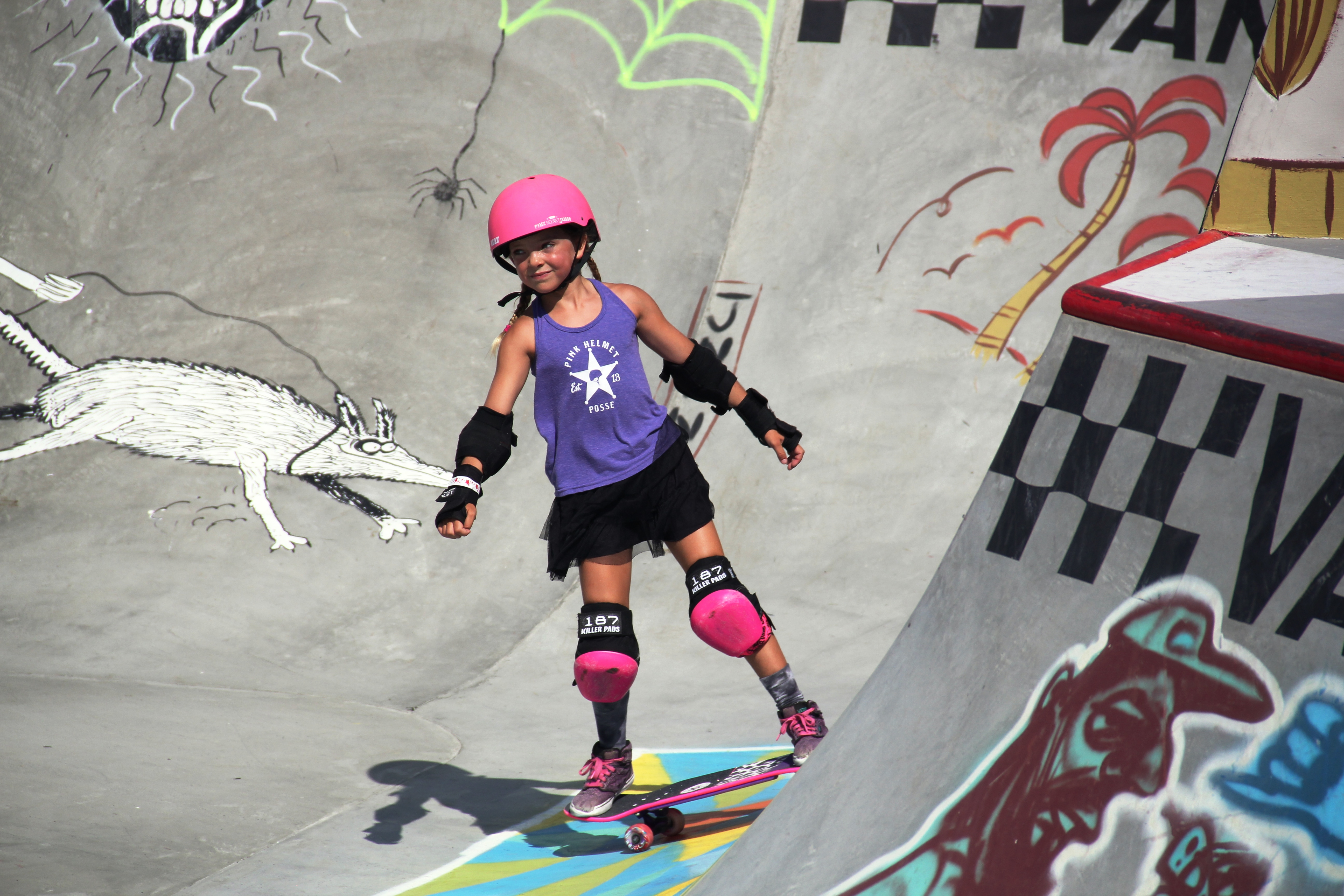 Bella Kenworthy, a 7-year-old from Dana Point, is part of the Pink Helmet Posse, which travels around Southern California to skateparks and tournaments in hopes of getting more girls involved in skateboarding. Here, Bella skates at the U.S. Open of Surfing in Huntington Beach. Photo: Sean Robb