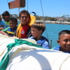Members of the Boys & Girls Club of the South Coast Area work together to hoist up the historic Schooner Curlew's mainsail. Youngsters embarked on a journey Tuesday, July 22 to a healthier lifestyle, led by longtime Orange County pediatrician Edward Taub. Photo: Andrea Papagianis