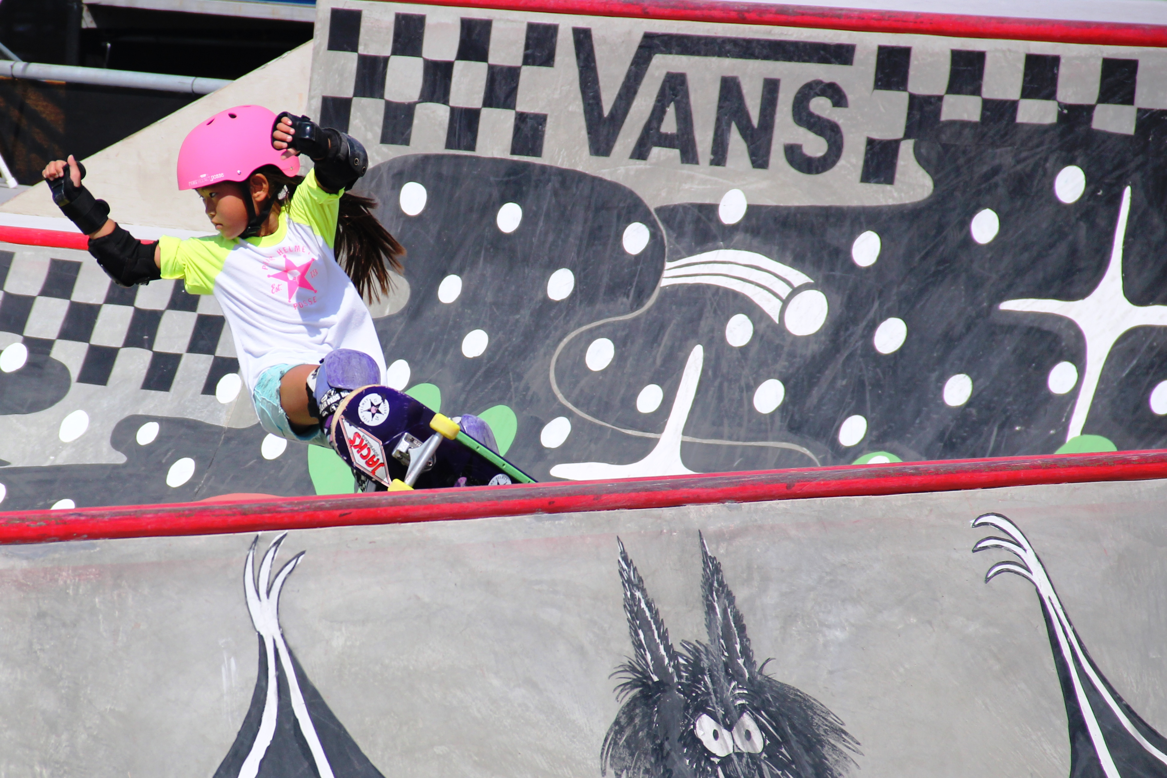 The Pink Helmet Posse, a group of five elementary to high school aged girls who are changing the face of the skateboarding community, is known around Southern California for their bright pink skateboarding gear. Pictured here, Relz Murphy, 7, skates before the pros. Photo: Sean Robb