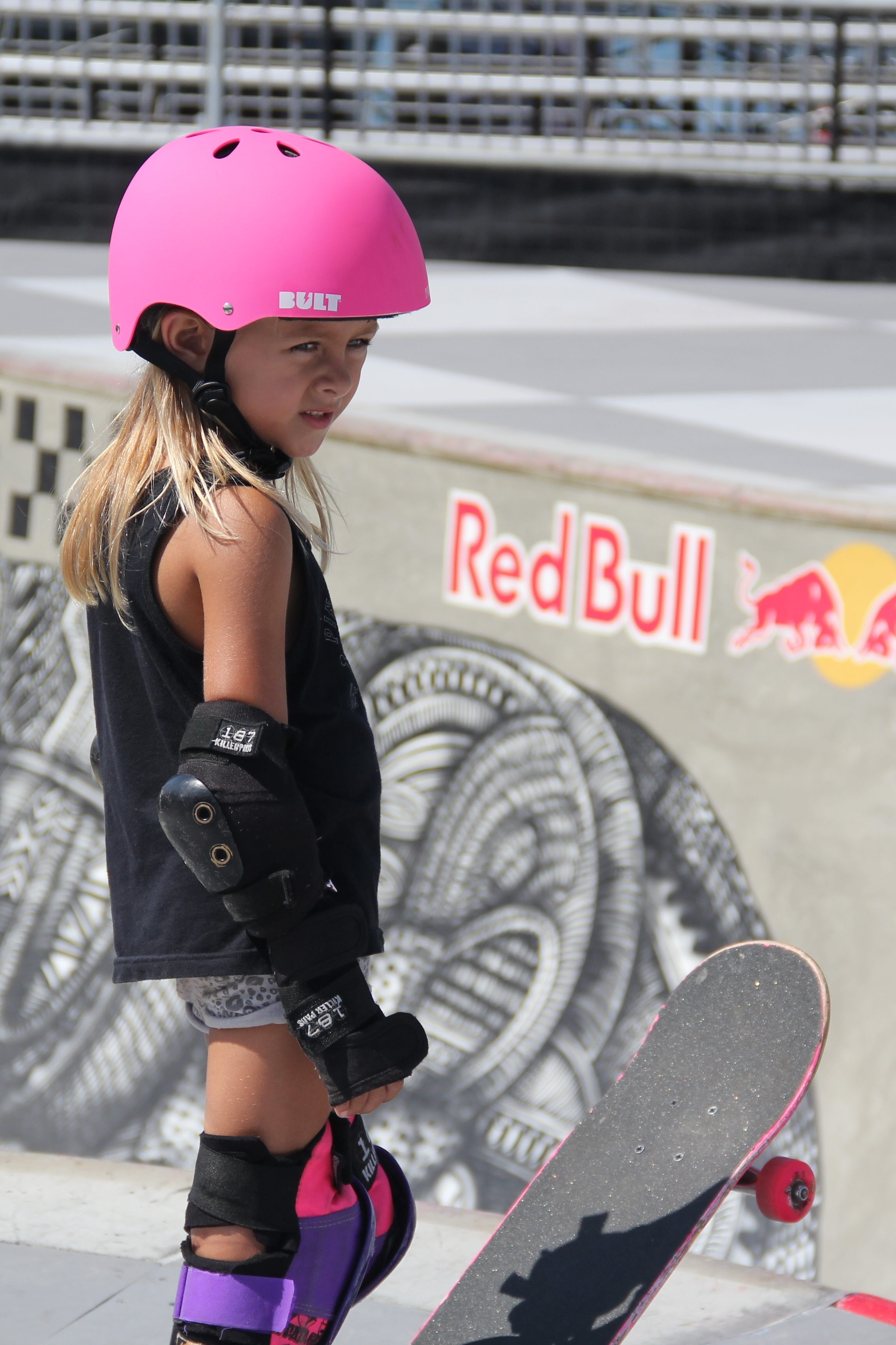 Known for introducing their pink helmets, skateboards and loud socks to skateparks across Southern California, the all-girl Pink Helmet Posse showed off their skills at the U.S. Open of Surfing Tuesday morning. Here, Ryann Cannon readies for a ride. Photo: Sean Robb