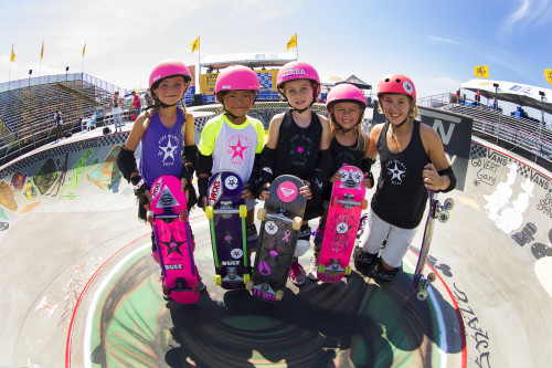 The Pink Helmet Posse, a group of five young, female skateboarders from ages 4 to 15, is spreading their love and passion for skateboarding to young girls throughout Southern California. Here the posse stops for a picture after a demonstration at the U.S. Open of Surfing in Huntington Beach. Pictured (L to R) Bella Kenworthy, Relz Murphy, Sierra Kerr, Ryann Cannon and Jordyn Barratt. Photo: Jason Kenworthy Photography