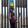 Will Schmidt, a Laguna Niguel resident and former U.S. Marine, completed a 61-day unassisted stand-up paddleboard journey between the Canadian and Mexico borders to raise money and awareness for the nation's wounded warriors. Here, Schmidt stands at the U.S.-Mexico border fence in San Diego's Imperial Beach. Courtesy photo