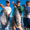 From L to R: Hieu Vo, Jimmy Bass and Bobby Fet show off their catch aboard a Dana Wharf Sportfishing boat. Courtesy photo