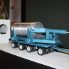 A model illustrates the process of placing spent fuel into dry cask storage. Photo: Jim Shilander