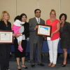 Kapil Mather, joined by his family and an employee, was presented with certificates of recognition by Dana Point Chamber of Commerce Director Heather Johnston and Mayor Lisa Bartlett (fifth and sixth from left, respectively) at the Oct. 7 City Council meeting, when his business, Mathnasium, was chosen as the Dana Point Business of the Month. Photo: Andrea Swayne