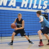 Dana Hills junior point guard Grady Yould dribbles around a teammate during practice. Photo: Steve Breazeale