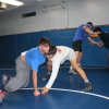 Senior Gevork Manoukian, left, grapples with teammate Marlon Gomez during a Dana Hills wrestling practice. Photo: Steve Sohanaki
