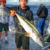 Dana Point resident Andrew Lasarge shows off a yellowtail caught aboard the Sum Fun. Courtesy photo