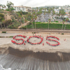 "Advocates for keeping Saddleback Memorial San Clemente hospital spell out  ""SOS"" on the beach near San Clemente Pier. Photo: Courtesy Erik Leist"