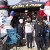 Young WSA competitors line up to present their Toys for Tots donations during last year's event at the San Clemente Pier. Photo: Sheri Crummer