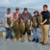 Anglers display halibut caught aboard the Clemente. Courtesy photo