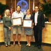 (L to R) Dream Catcher Yachts owners Robin and Kenzie Lobacz accept recognition as Dana Point Business of the Month for April by Chamber of Commerce Executive Director Heather Johnston and Mayor Carlos Olvera at the April 7 City Council meeting. Photo: DyAnne Weamire