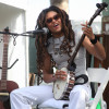 Tennessee native Valerie June plays the banjo during her set on the Backporch Stage Sunday afternoon. Photo: Allison Jarrell