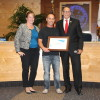 Art Sea owner Mark Hanson (center) accepts recognition as Dana Point Business of the Month for May by Chamber of Commerce Executive Director Heather Johnston and Mayor Carlos Olvera at the May 5 City Council meeting. Photo: Andrea Swayne