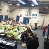 A large crowd attended Tuesday night's City Council meeting at the Community Center sporting green T-shirts in support of the South Shores Church expansion project approved that night by a unanimous vote. Photo: Andrea Swayne