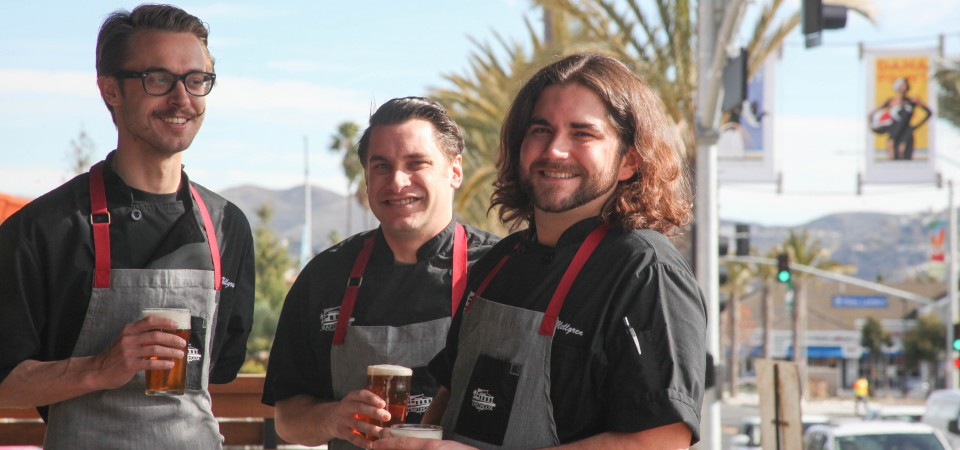 Craft House owner and chef Blake Mellgren, sous chef Crews Wells and sous chef Jason Naaman share craft beers on the patio of the soon-to-open Dana Point Lantern District restaurant.