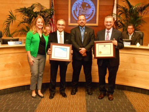 Heather Johnston, Dana Point Chamber of Commerce executive director; restaurant general manager Stefano Xenos; Mayor John Tomlinson and restaurant owner Chris Lagaris stand at the City Council dais at the presentation of Business of the Month honors to Casanova Ristorante. Photo: Rachel Johnson