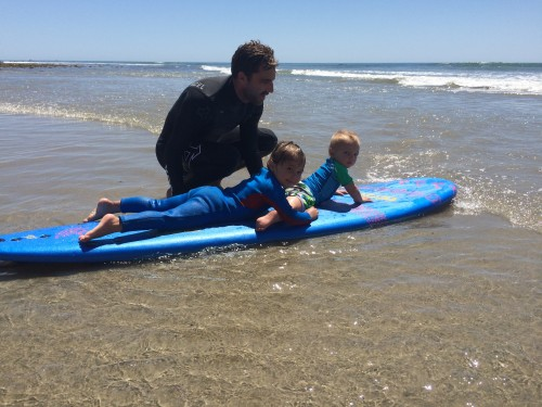 San Clemente-based professional surfer Nathan Yeomans enjoys a day at San O with his children, Isabella and Isaac, delighted by their interest in learning to surf. Photo: Jenny Yeomans