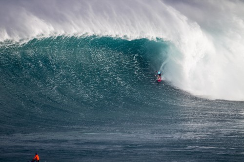 2015/2016 Big Wave World Champion Greg Long of San Clemente pulls into a massive barrel at Jaws during the Pe'ahi Challenge. Photo: WSL