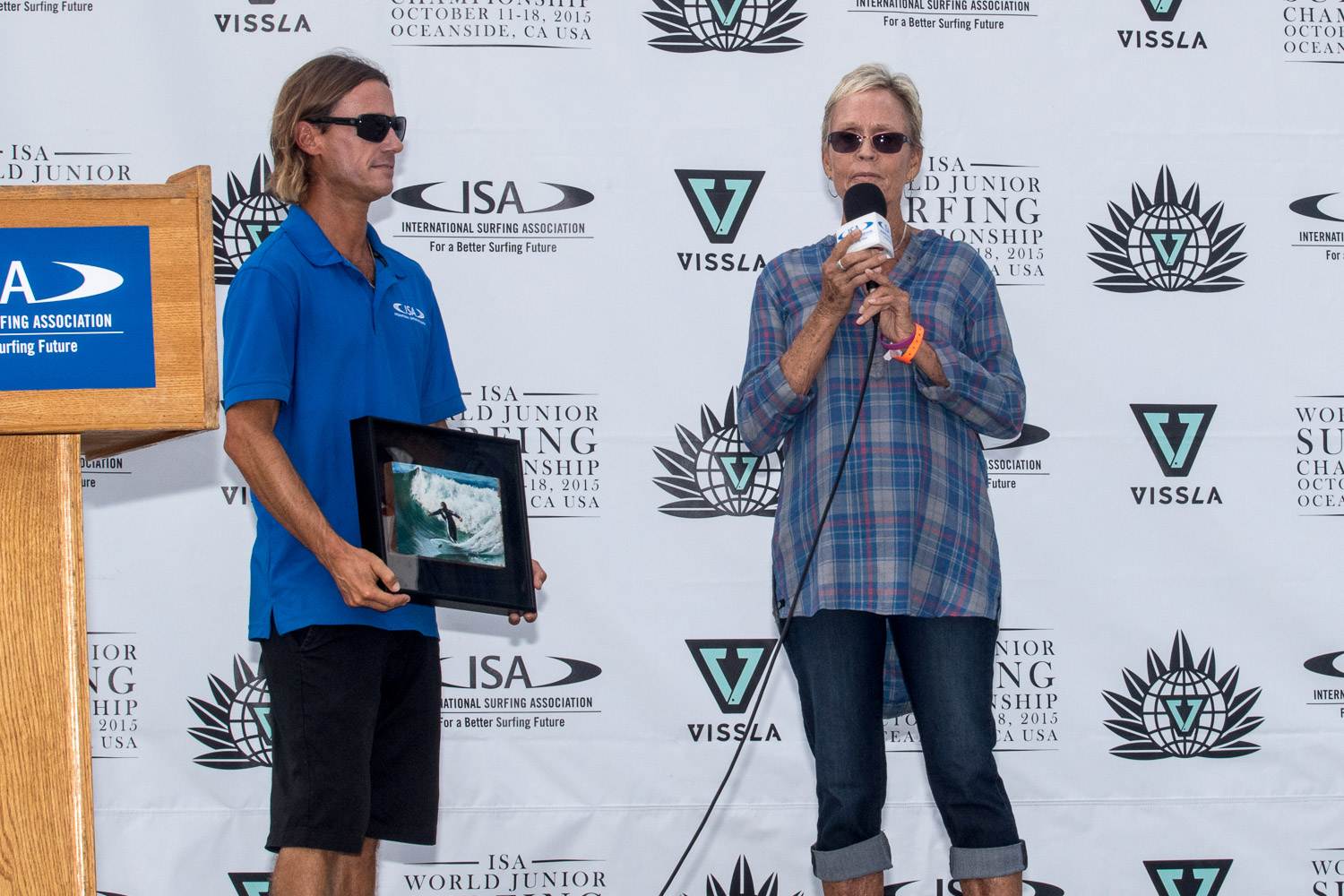 Mary Lou McGinnis Drummy accepts an award last year from the ISA World Jr. Championship. This year, the surfing icon will enter the Surfing Walk of Fame. Photo: Surfing America/Jack McDaniel
