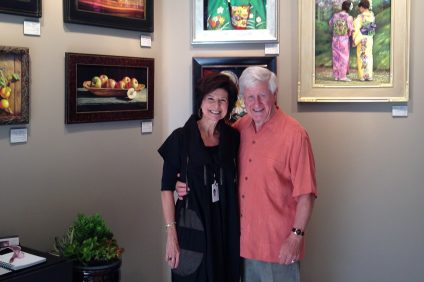 Marie and Ron Tippets pose for a photo during opening night of Festival of Arts in Laguna Beach. Photo: Courtesy of Marie Tippets