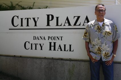 Carlos Olvera stands in front of City Hall. Olvera will not be seeking re-election this fall. Photo: Kristina Pritchett
