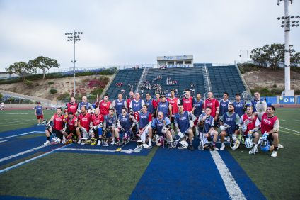 Active-duty military and veterans gather for a photo following a game at Shootout for Soldiers. Photo: Charlie Gressett