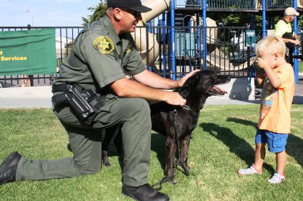 Beau Eriksen, 4 of Dana Point, takes photos of Rhino during Dana Point's Second Annual National Night Out at Sea Canyon Park on Tuesday, August 2. Photo: Kristina Pritchett