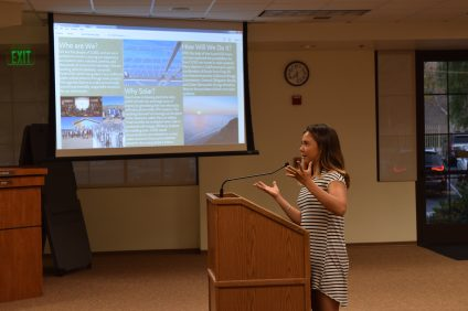 Erika Hunting, San Clemente High School junior and president of the Blue Oceans Club, speaks to the CUSD Board of Trustees on Aug. 17 about the potential benefits of solar panels on campus. Photo: Courtesy of Zain Faruqi