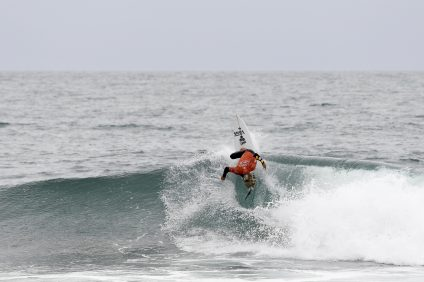 Tanner Guduaskas surfing during Heat 3 of The Quarterfinals at The Hurley Pro Trestles