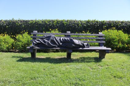 A sculpture of Jesus as a homeless man on a bench at St. Edward the Confessor church in Dana Point.  Photo: Matt Cortina