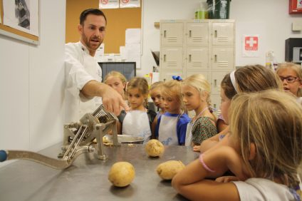 Brownie Troop 3532 went to Dana Point's Coastal Kitchen to learn how to cook some of the restaurant's dishes, including fries and bread with Chef Andrew Palma. Photo: Kristina Pritchett