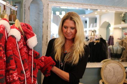 Beth Oas adjusts some of the robes inside her store Lingerie Paradis in Monarch Beach. Photo: Kristina Pritchett