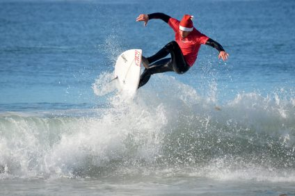 The Surfing Santa Competition is a local holiday tradition, where surfers compete on the waves in seasonal garb. Photo: Courtesy