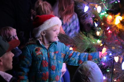 Shannon, a Capistrano Beach resident, looked at the lights on the tree in Pines Park during the tree lighting ceremony on Monday, Dec. 5. Photo: Kristina Pritchett